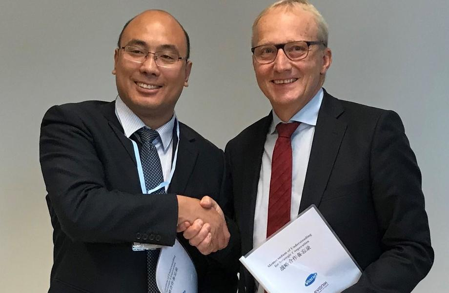 Dr Yingjun Zhou, left, general manager of Shandong Vland Biotech, and Dr Reiner Beste, chairman of the Evonik Nutrition & Care, shake hands on the deal. Photo: Evonik.