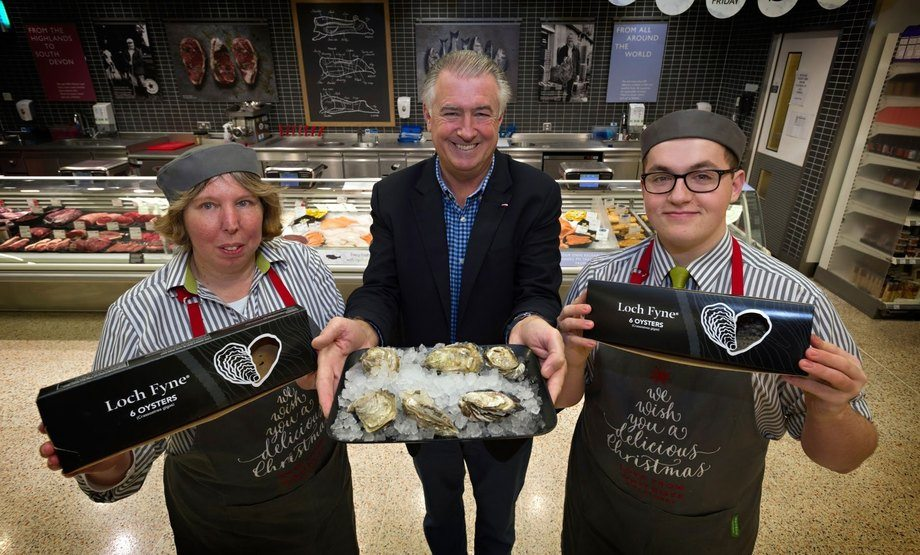 Loch Fyne Oysters sales director Simon Briggs, centre, with Waitrose counter staff Cate Lee and Tom Sparks. Photo: Loch Fyne Oysters