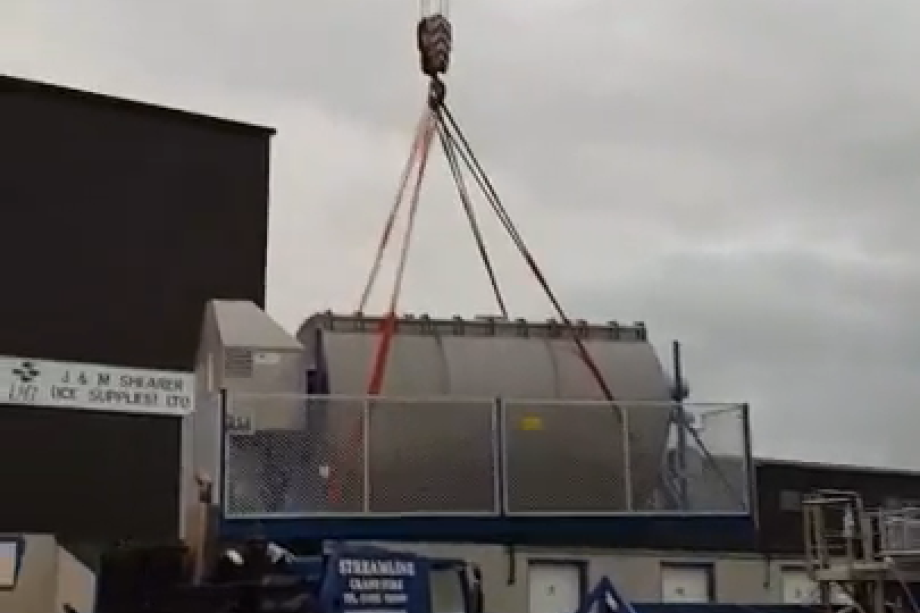 Mørenot Scotland's 52m³ net washer is lifted on to the firm's site in Scalloway, Shetland. Video still: David Goodlad.