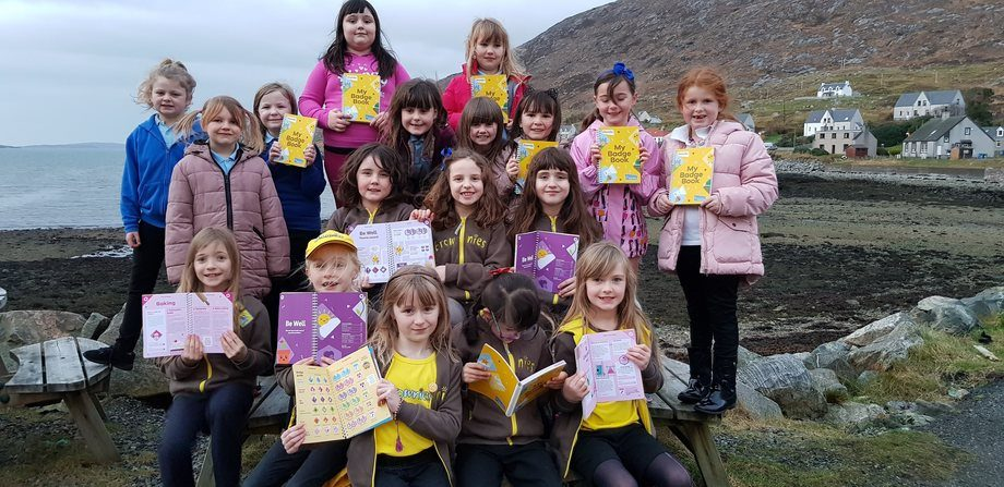 Isle of Harris Brownies with their new badge books bought by SSC. Photo: SSC.