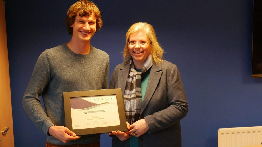 Ben Weiss, Mowi farm manager, is presented with his certificate by SSPO sustainability director Anne Anderson. Photo: FFE.