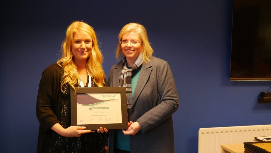 Mowi's new Uist and Barra area manager Connie Pattillo, left, pictured being presented with a certificate by the then Scottish Salmon Producers' Association sustainability director Anne Anderson after completing a junior executive development programme in 2019. Photo: FFE.