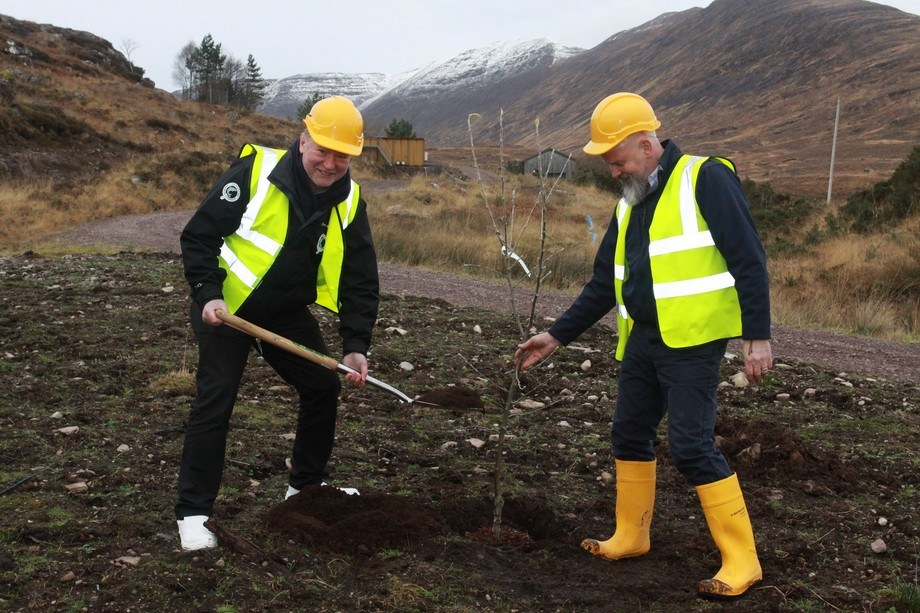 Richard Polanski, SSC recirculation project manager, helps chief executive Craig Anderson, left, plant a tree at the Applecross site. Photo: SSC.