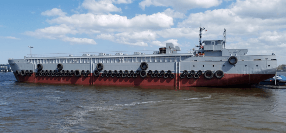 HiddenFjord's new feed barge, converted from a bulk carrier, is designed to withstand some of the world's toughest fish farming conditions. Photos: JT electric.
