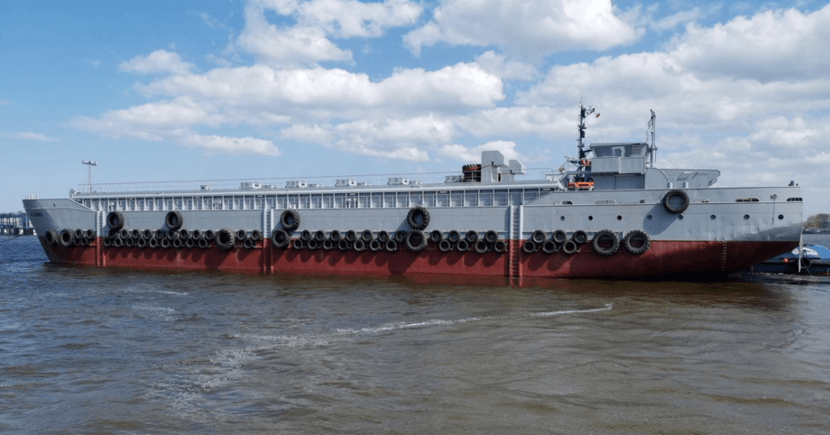 JT electric recently delivered this 850-tonne capacity barge, converted from a bulk carrier, to Faroes salmon farmer Hidden Fjord but aims to supply smaller, new-build barges in Scotland and Norway. Photo: JT electric.