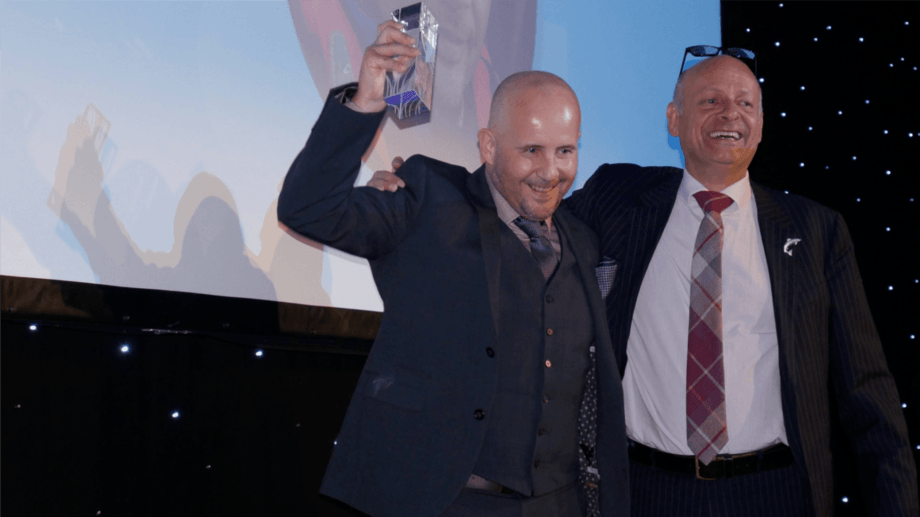 A winner by smiles: SSF's Orkney production manager Richard Darbyshire, left, is presented with the People's Choice award by Campbell Morrision of Europharma, which sponsored the category. Photo: Gareth Moore / FFE.