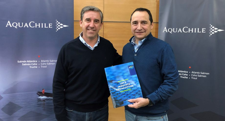 AquaChile boss Sady Delgado, left, and BioMar's Eduardo Hagedorn at the handover of AquaChile's share of the feed plant. Photo: BioMar.