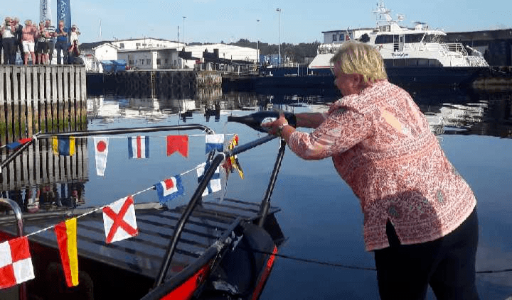 Norwegian prime minister Erna Solberg christens the Evoy 1, which may be the world's fastest electric boat.