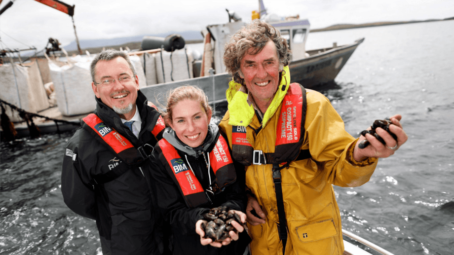 From left: Jim O'Toole, Jo Pollett and Michael Mulloy celebrate the rope-grown mussel industry gaining MSC certification. Photo: BIM.
