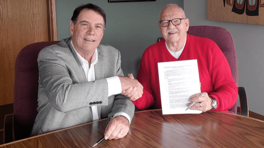Jim Parsons, general manager of Cooke Aquaculture Pacific, and Ron Allen, Tribal Council chair/CEO of the Jamestown S'Klallam Tribe, signing the partnership agreement. Photo: Cooke.
