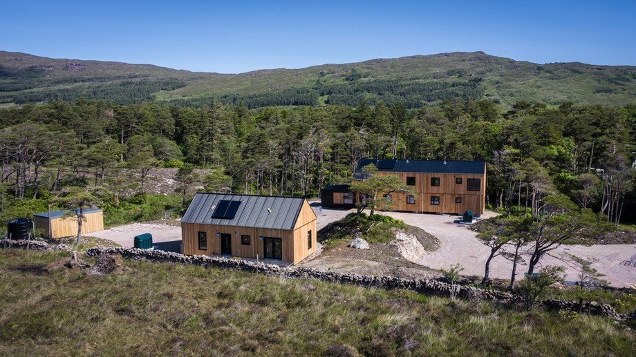 The manager's house, foreground, and accommodation block on Rum. The six bedrooms in the block are en-suite, split across two storeys, with each level having its own kitchen living and dining area. There is also an attached visitor's annex. Photo: Mowi Scotland.