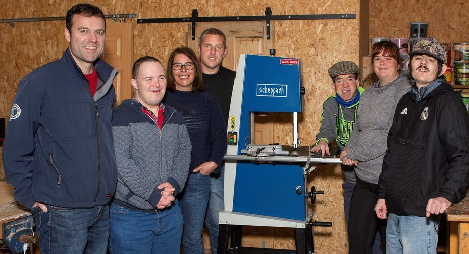 From left: Paul Condy, sustainability coordinator of SSC Marybank in Lewis, Iain Macleod, Gayle Walker, Macaulay College director Roland Engebretsen, Ethan Mitchell, Rachel Bibby and David Montgomery with a new bandsaw bought with a donation from SSC. Photo: SSC.