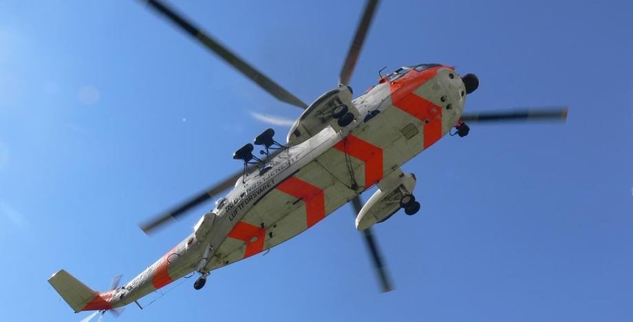 A rescue helicopter was used in the search and winched one man to safety. File picture: HRS.