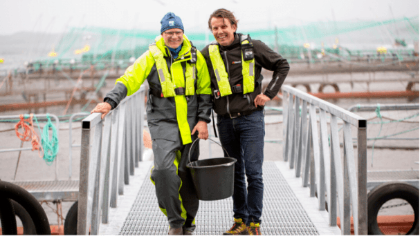 Jan Ivar Bildøy, Blom Fiskeoppdrett, left, with Oystein Larsen, aqua division manager, Alltech Norway at one of the six salmon farms participating in Alltech and Nofima research into sustainable salmon production. Photo: Alltech.