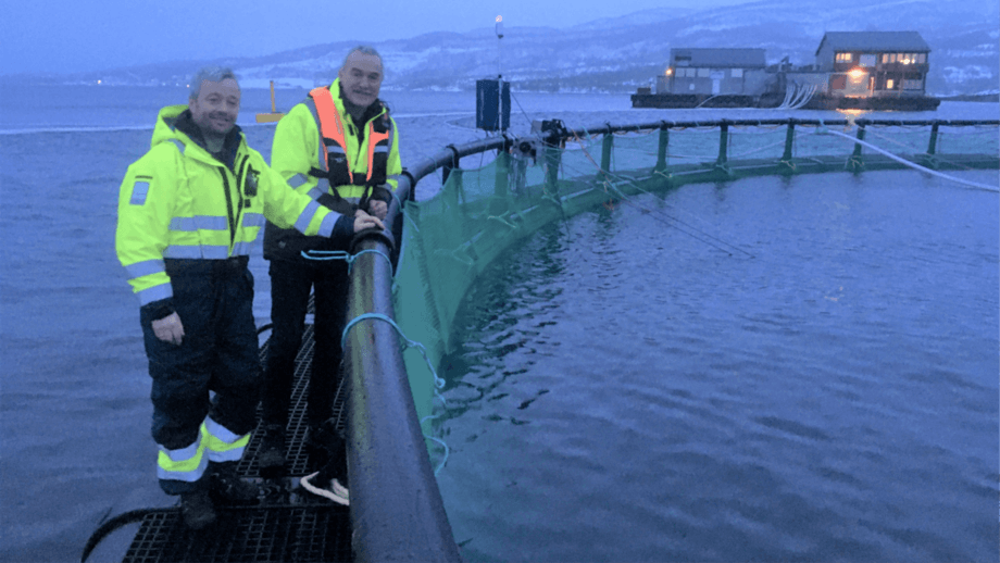 Arctic Havservice director Helge Stormyr, right,  meets a fish farmer in the Nordland region of Norway to discuss the AutoBoss net washer. Photo: Arctic Havservice / Trimara.