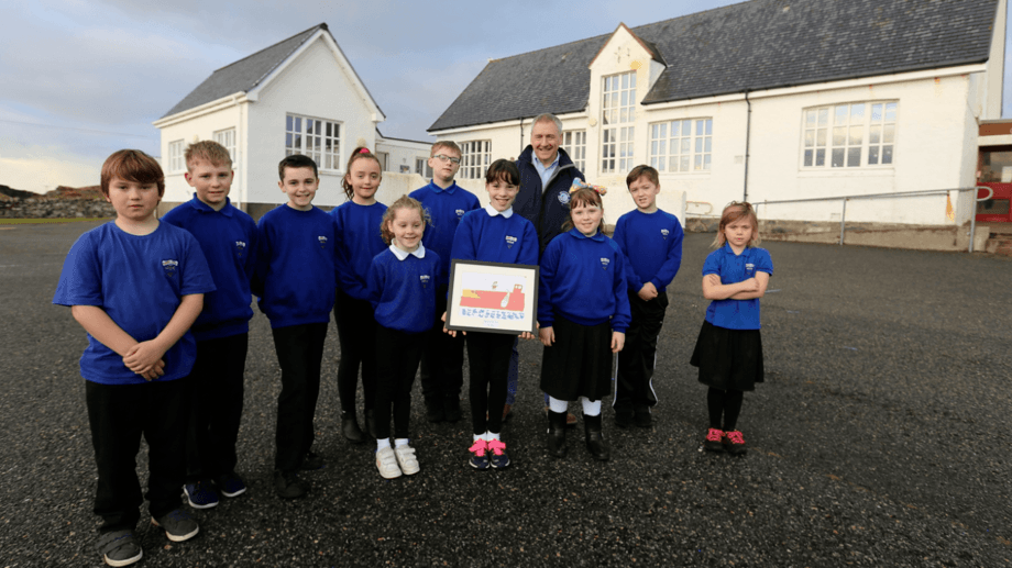 Stuart Witts, SSC area manager for East Loch Roag in the Isle of Lewis with Ava Douglas and classmates before the schools were closed. Photo: SSC.