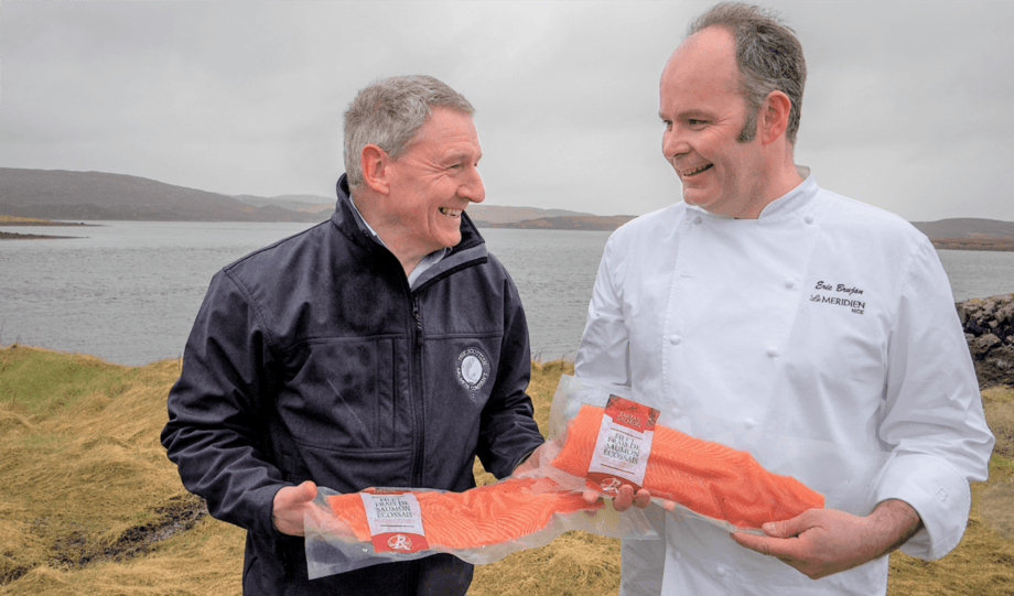 Stuart Witts, SSC's area manager for Loch Roag, and French chef Eric Brujan with SSC's vacuum-packed salmon fillets during Brujan's visit to Scotland before the Covid-19 pandemic. Photo: SSC.