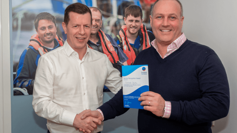 SSF managing director Jim Gallagher, left, presenting Graham Smith with his 15 years long-service certificate in 2019. Photo: ©SSF.