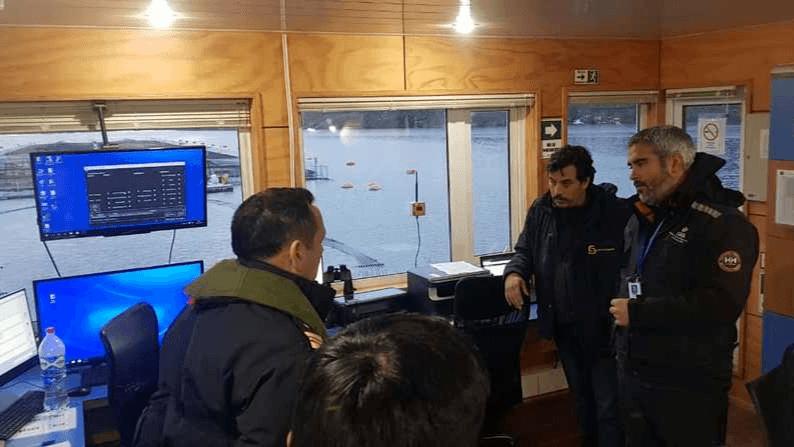 An inspection by Sernapesca officials at a Nova Austral salmon farm. Photo: Sernapesca.
