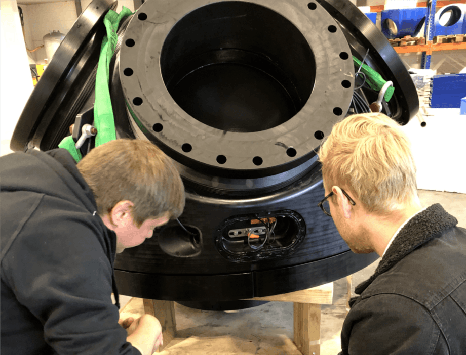 Cflow engineers inspect a valve during development of the Flowline system. Photo: Cflow.