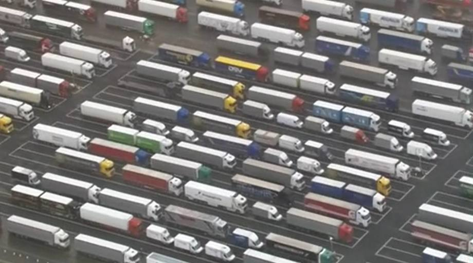 Just a fraction of the 3,000 or more lorries waiting at Manston Airport in Kent to cross to France. Photo: BBC.