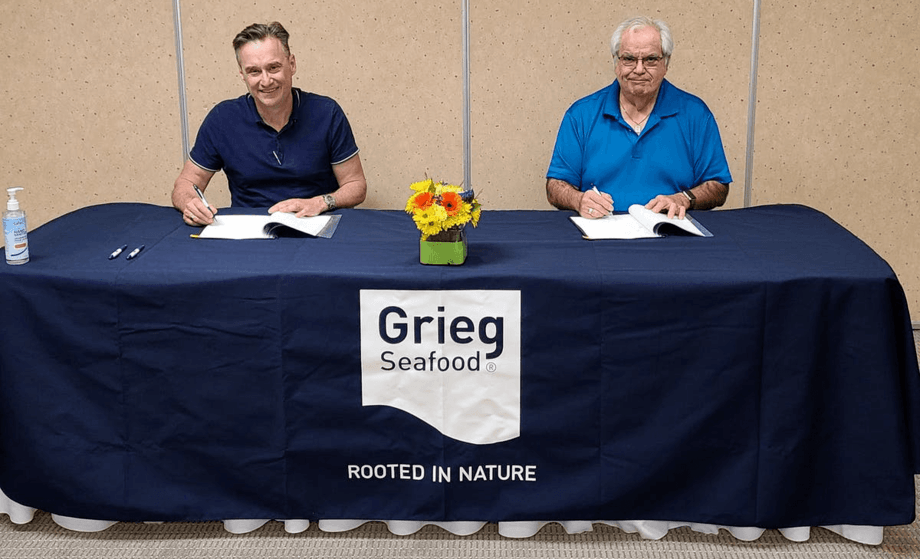 Grieg Seafood BC managing director, Rocky Boschman, left, and Councillor Thomas Smith sign the contract. Photo: Grieg Seafood.