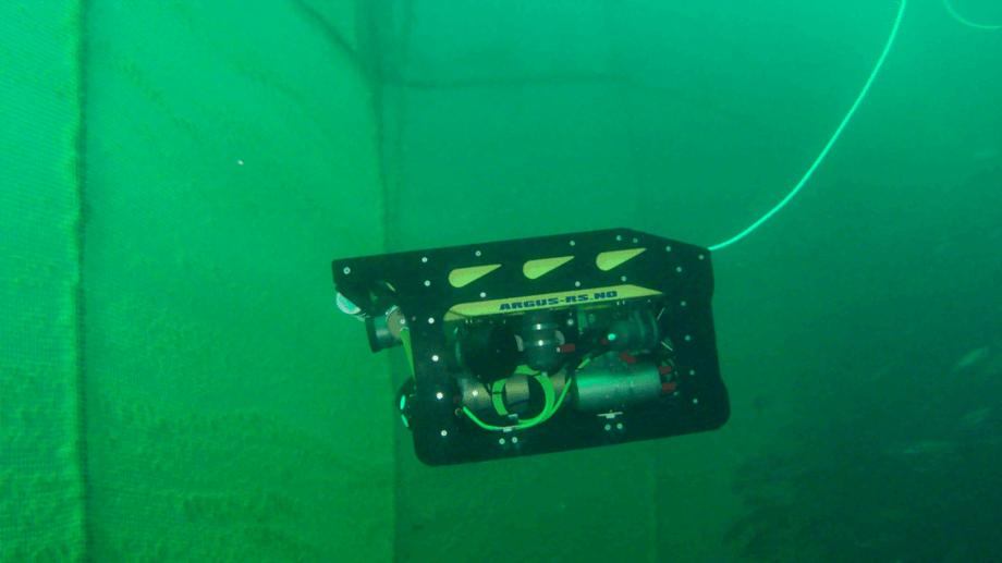 The Artifex ROV during trials. The Nortek DVL transducer windows are visible bottom left, facing the net. Photo: SINTEF Ocean AS.