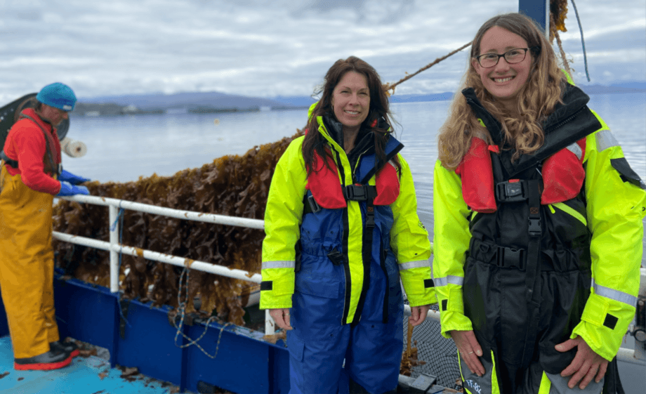 Mowi Scotland senior environmental analyst Yvonne Booth, left, and environmental analyst Laura Tulip at Scalpay, near Skye, where sugar kelp grown next to a salmon farm is being harvested. Photo: Mowi.