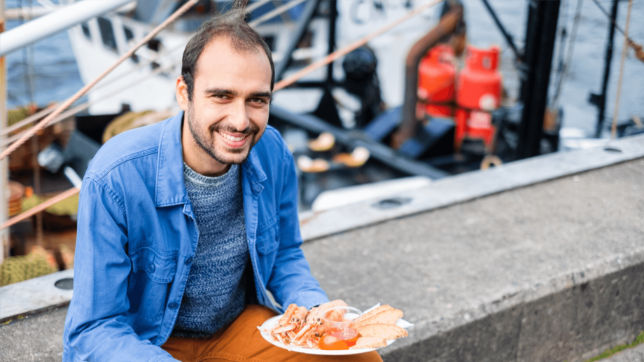 Rise-Up project researcher George Charalambides, from SAMS, at the Railway Pier in Oban, one of many towns that benefits from a thriving seafood sector. Photo: SAMS.