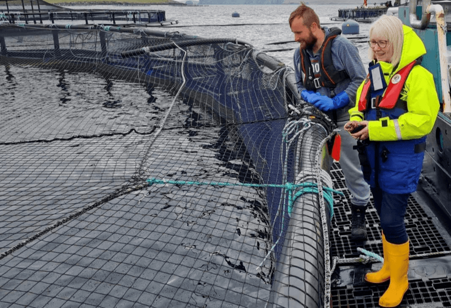 Shetland MSP Beatrice Wishart with Shetland regional manager David Brown during a visit to Cooke Aquaculture Scotland's Vee Taing salmon farm today. Photo: Cooke Aquaculture Scotland.