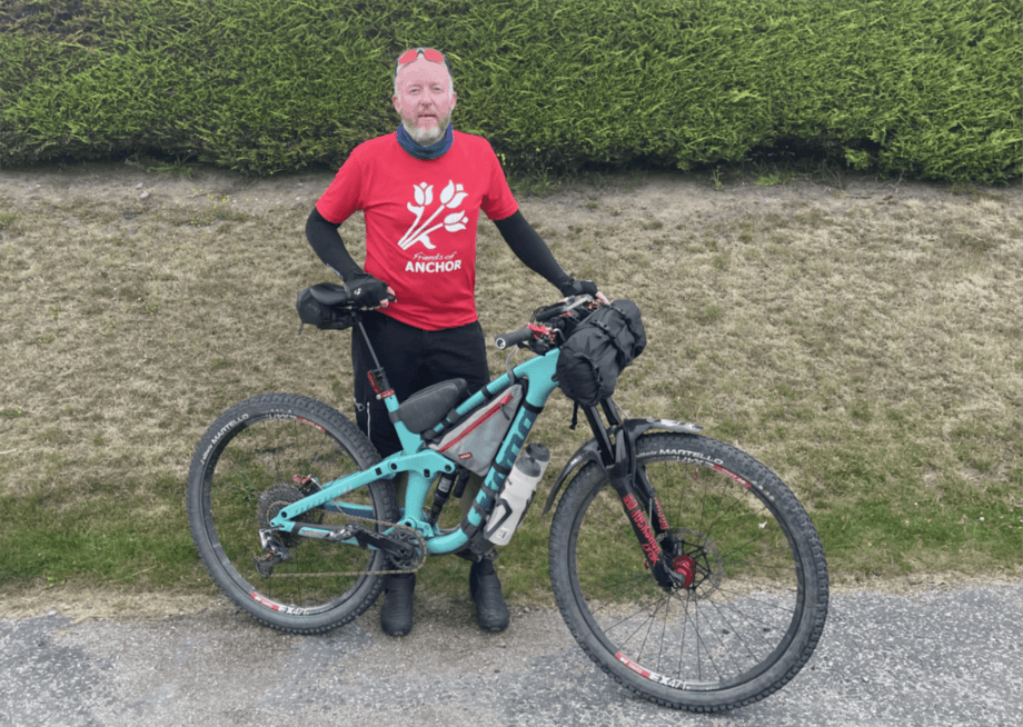 Chris Hyde with the bike on which he will ride 500 km off-road across Scotland to raise money for the charity supporting the cancer unit that saved his son's life. Photo: Chris Hyde.