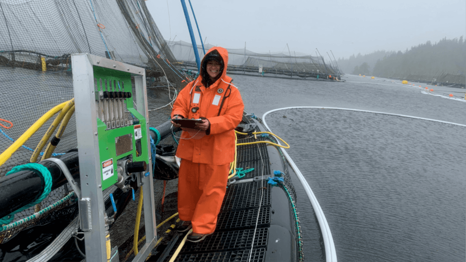 Mowi Canada West water quality assistant manager Sandra Huynh sampling in the rain. Photo: Mowi.