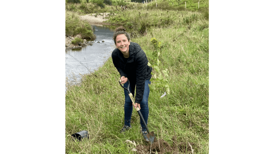 Scotland's Rural Affairs Secretary Mairi Gougeon planting a tree to help shade a salmon river in Angus. Photo: Scottish Government.