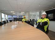 <p>Daglig leder Øyvind Risenes og prosjektleder Frode Johansson ved det som er møte- og spisebord om bord. I bakgrunnen skimtes kontrollrommet og bak til høyre er kjøkkenet.</p>