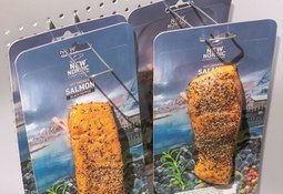 Salmon smoker chooses lower-plastic packs