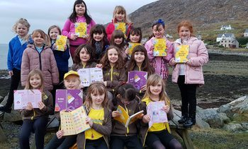 Salmon farmer buys badge books for Brownies