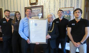Provost presents second Queen's Award to aquaculture innovator