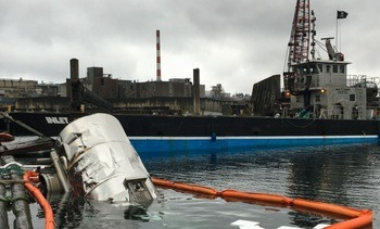 Reports of pink liquid spilling from barge