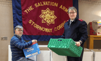 Salmon farmer helps food bank continue in lean times