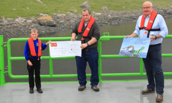 Cheque this out: salmon farmer rewards pupil and his school for naming boat